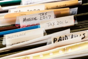 An estate planning binder would make it easier for an executor to sort through a deceased relative's financial information.